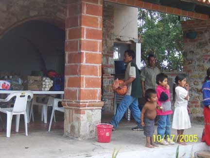 Unloading food at campiemento, kids are very interested in what is going on