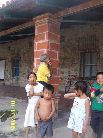 Huichol children with grampa in the back